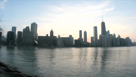 Lake-Michigan-reflects-the-Chicago-skyline-as-evening-darkens-into-a-colorful-sky