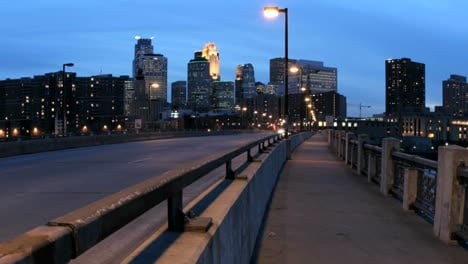 Pan-left-across-streaks-of-light-from-accelerated-traffic-accentuating-the-foreground-as-the-Minneapolis-skyline-darkens-in-the-fading-sunlight