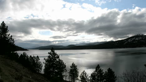 Bright-sunlight-pierces-through-storm-clouds-passing-over-an-Idaho-Lake
