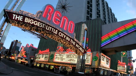 Timelapse-shot-of-traffic-passing-under-a-welcome-sign-for-Reno-Nevada-the-Biggest-Little-City-in-the-World-s