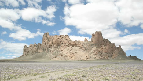 Fluffy-white-clouds-pass-over-New-Mexico\-s-Shiprock