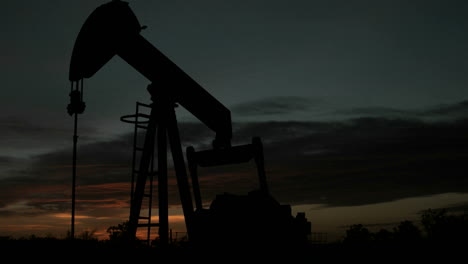 Time-lapse-shot-of-an-oilrig\-s-movement-throughout-the-day-and-into-the-night
