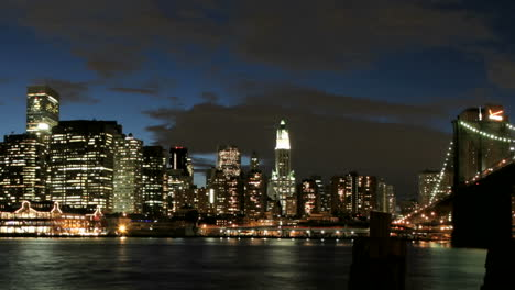 Slow-pan-of-a-timelapsed-view-of-the-Brooklyn-Bridge-and-the-New-York-City-skyline-from-goldenhour-to-night