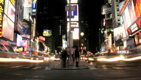 Shot-slowly-pans-right-in-an-accelerated-shot-of-traffic-and-pedestrians-in-New-York-s-Times-Square