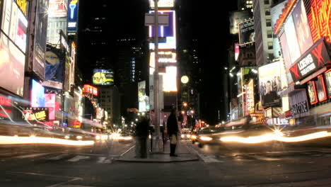 A-slow-left-pan-of-an-accelerated-shot-of-traffic-and-pedestrians-in-New-York-s-Times-Square