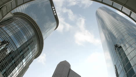 Slow-upward-pan-of-the-Houston-Oil-Company-Buildings-seen-from-beneath-an-arch