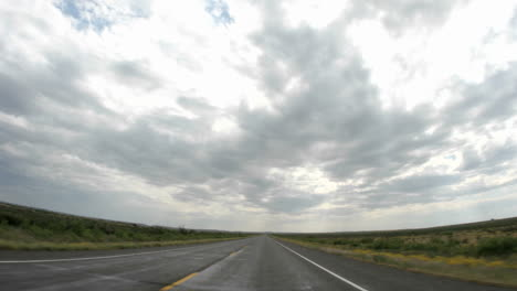 Point-of-view-accelerated-shot-of-driving-down-a-rural-Texas-highway