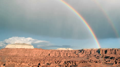 A-rainbow-glows-in-the-sunlight-as-it-arches-over-Goblin-Valley-State-Park
