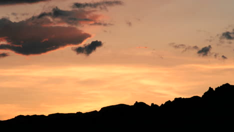 Slow-rightpan-of-bright-orange-colors-in-the-goldenhour-sky-intensifying-and-fading