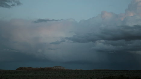 Storm-clouds-in-the-goldenhour-take-on-muted-shade-of-pink-and-blue-then-fade-into-darkness