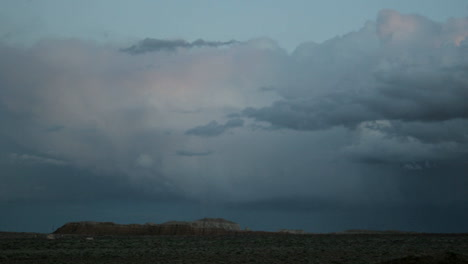 Storm-clouds-in-the-goldenhour-take-on-muted-shade-of-pink-and-blue-then-fade-into-darkness-1