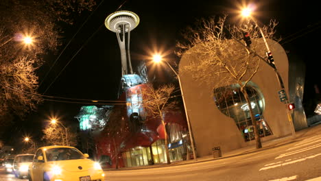 Accelerated-traffic-stops-and-then-blurs-into-streaks-of-light-in-front-of-the-Seattle-Space-Needle-and-surrounding-buildings