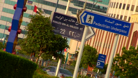 Signs-in-English-and-Arabic-line-a-highway-in-the-United-Arab-Emirates