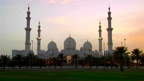 The-spires-and-minarets-of-the-beautiful-Sheikh-Zayed-Mosque-in-Abu-Dhabi-United-Arab-Emirates-at-dusk