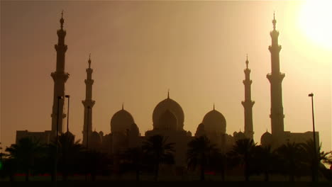 The-spires-and-minarets-of-the-beautiful-Sheikh-Zayed-Mosque-in-Abu-Dhabi-United-Arab-Emirates-at-sunset