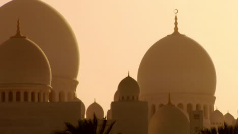 The-domes-of-the-beautiful-Sheikh-Zayed-Mosque-in-Abu-Dhabi-United-Arab-Emirates-at-sunset