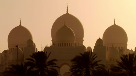 The-domes-of-the-beautiful-Sheikh-Zayed-Mosque-in-Abu-Dhabi-United-Arab-Emirates-at-sunset-1
