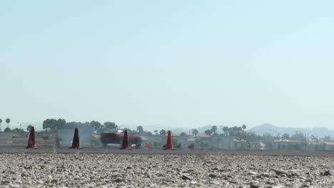Low-Shot-Of-A-Red-Car-As-It-Smokes-Its-Tires-Through-A-Drifting-Course-At-Camarillo-Airport-In-Camarillo-California
