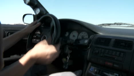 A-Pov-Shot-From-Inside-A-Car-As-A-Test-Driver-On-Track-Takes-It-Through-Maneuvers-During-Drifting