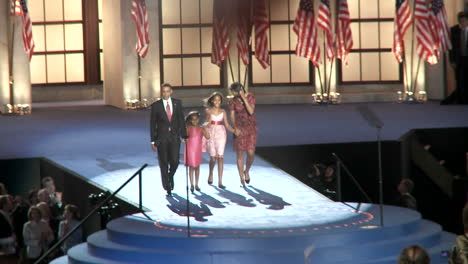Zoom-Out-From-Presidential-Nominee-Barack-Obama-And-His-Family-As-A-Packed-Investco-Field-Claps-Cheers-And-Waves-Flags-At-The-End-Of-The-2008-Democratic-National-Convention-In-Denver-Colorado