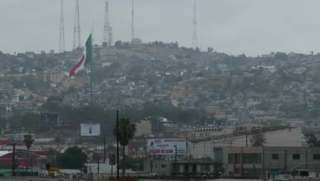 The-Mexican-Flag-Is-Seen-Waving-Above-Downtown-Tijuana-Mexico