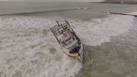 Aerial-Shot-Over-A-Shipwrecked-Fishing-Boat-Near-Ventura-California-2