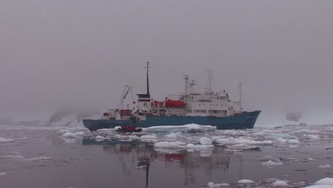 An-oceanic-research-vessel-floats-amongst-icebergs-in-Antarctica