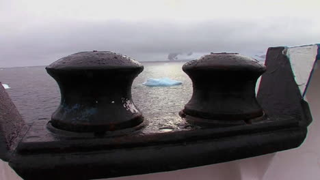 Artistic-shot-looking-through-tie-bars-to-see-ocean-below-with-icebergs-visible-