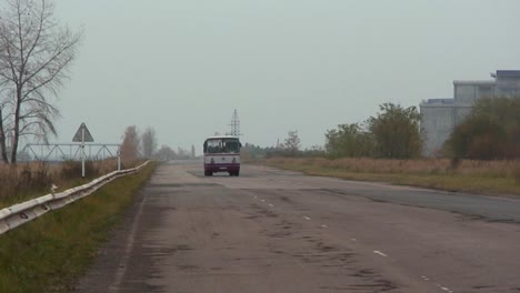 A-bus-passes-on-an-abaondoned-road-near-the-Chernobyl-nuclear-power-plant