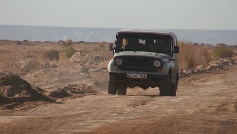 An-old-jeep-passes-on-a-road-near-the-Aral-Sea-in-Kazakhstan-or-Uzbekistan
