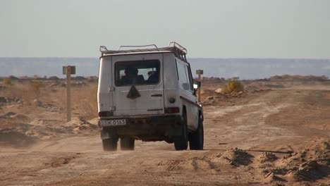 An-old-jeep-passes-on-a-road-near-the-Aral-Sea-in-Kazakhstan-or-Uzbekistan-1