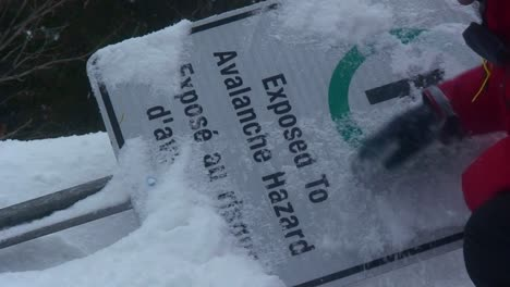 A-sign-warning-of-avalanches-is-buried-under-an-avalanche