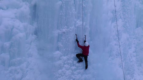 A-man-climbing-a-frozen-waterfall