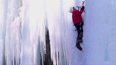 Close-up-of-a-man-climbing-a-frozen-waterfall
