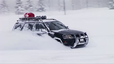 A-car-drives-and-does-spins-and-doughnuts-in-deep-snow