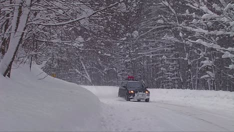 A-car-travels-on-a-snowy-mountain-road-1