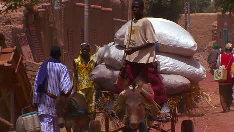 People-walk-and-ride-horsecarts-on-the-streets-of-town-in-Mali-Africa