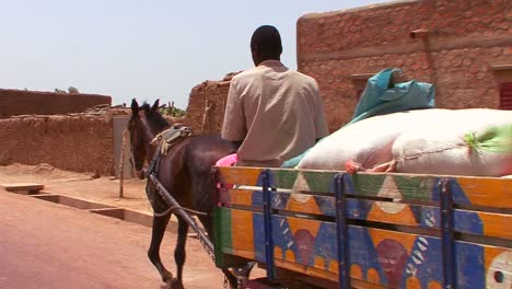 A-horse-cart-and-rider-on-a-rural-road-in-Mali