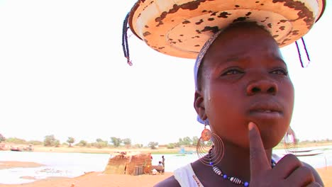 A-woman-sells-trinkets-and-other-good-along-the-roadside-in-Mali-Africa-1