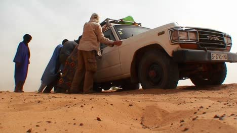 A-UN-type-jeep-gets-stuck-in-the-sand-on-a-road-in-rural-Mali
