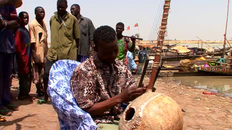 A-man-plays-a-beautiful-stringed-instrument-in-Mali-africa