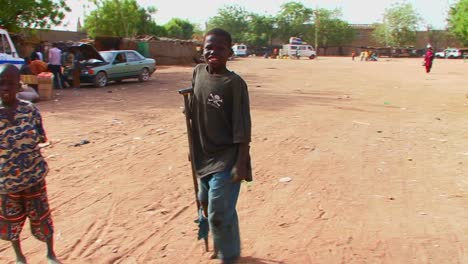 A-boy-walks-on-crutches-in-a-poor-African-town