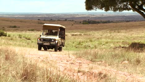 A-safari-vehicle-travels-across-the-plains-of-Africa