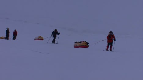 An-Arctic-expedition-moves-across-frozen-tundra-on-cross-country-skis-towing-supplies-1