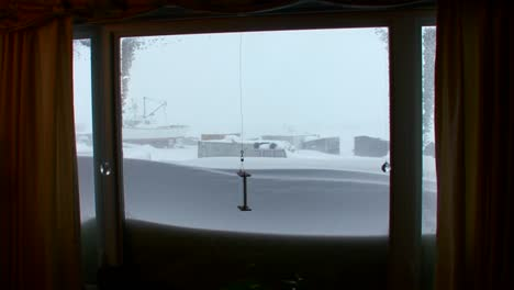 A-view-out-of-a-living-room-window-of-a-arctic-blizzard