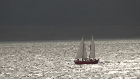 A-sailboat-travels-on-silvery-water