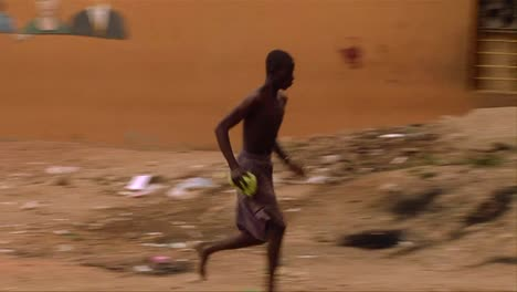An-African-man-does-a-bizarre-stunt-by-running-up-to-a-wall-and-doing-a-flip
