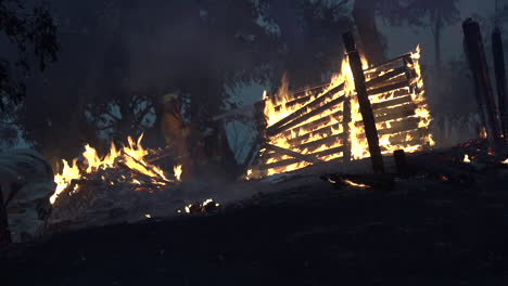 Fences-and-outbuildings-burn-during-a-massive-wildfires-in-Australia