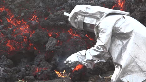 A-man-in-a-Lava-flows-from-the-Cabo-Verde-volcano-erupts-on-Cape-Verde-Island-off-the-coast-of-Africa