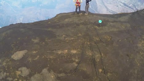 An-excellent-aerial-over-the-Cape-Verde-volcano-with-two-explorers-watching